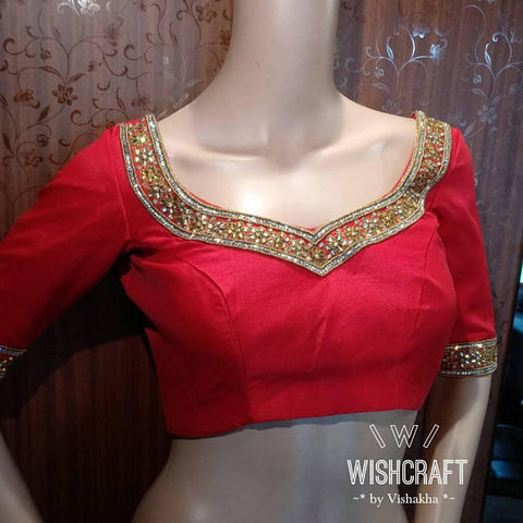 Beautiful necklace blouse with stones and kundan work