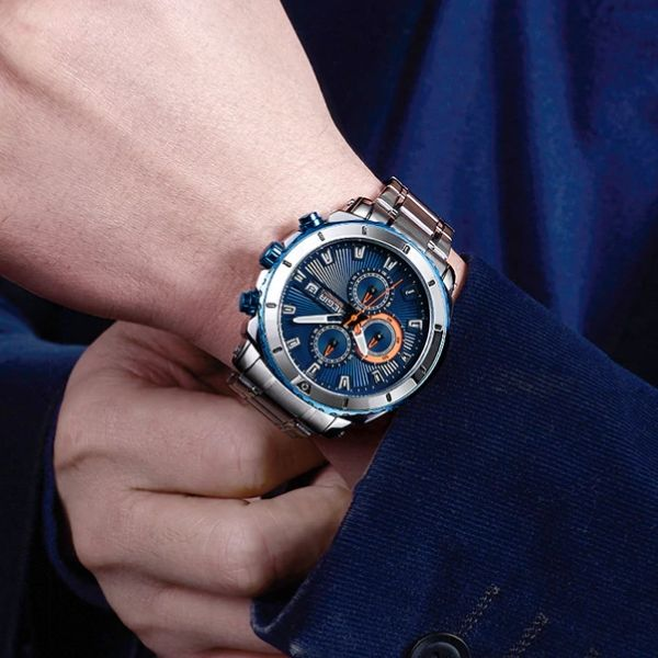 Man wearing Bigoza Stainless Steel Gents Watch with blue dial on wrist