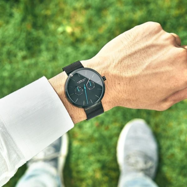 Man wearing Bluer Black Stainless Steel Watch with blue markers on wrist