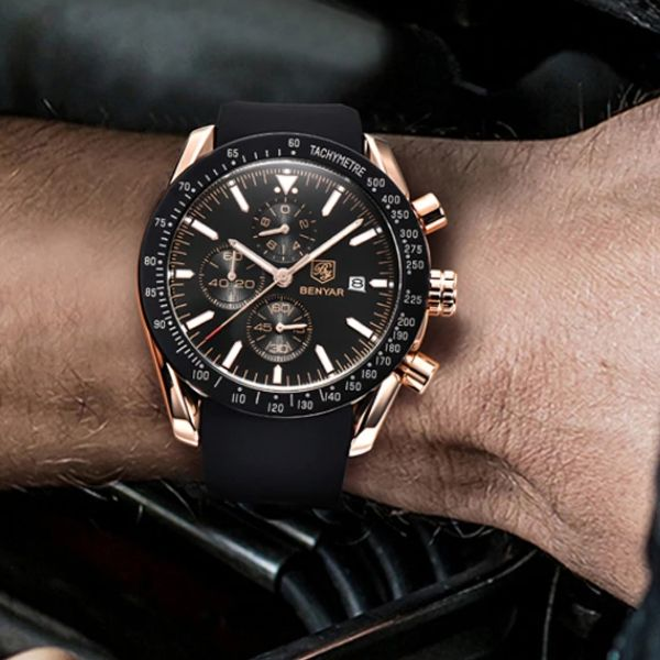 Man wearing Tazero Chronograph Wrist Watch For Men with gold-black markers on wrist