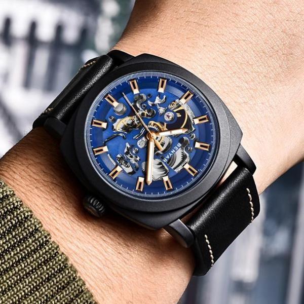 Man wearing black-blue Venal Skeleton Mechanical Watch on wrist