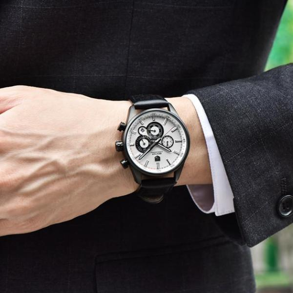 Man wearing Wilder Leather Chronograph Watch with white dial on wrist
