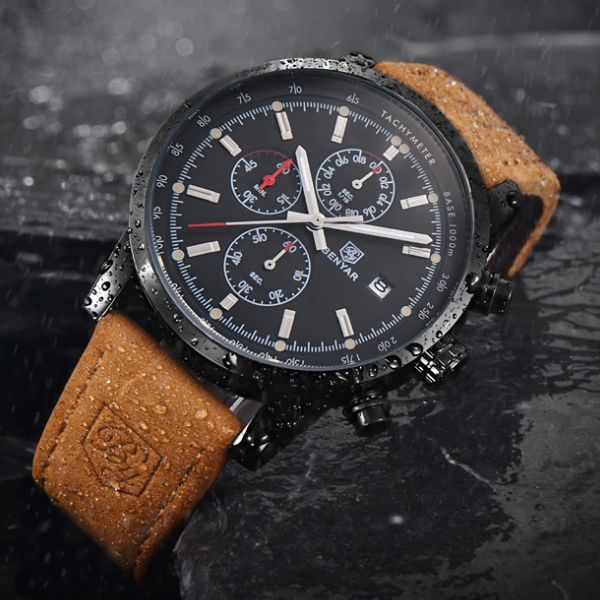 Front-facing image Grandio Chronograph Watch with black dial in rain and gray background