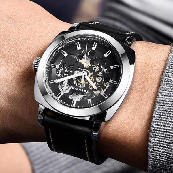 Man wearing silver-black Venal Skeleton Mechanical Watch on wrist