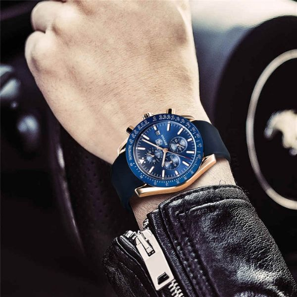 Man wearing Tazero Chronograph Wrist Watch For Men with gold-blue markers on wrist