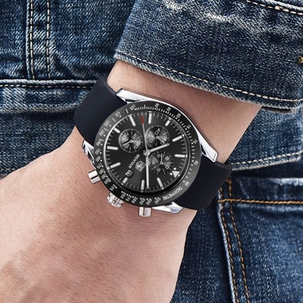 Man wearing Tazero Chronograph Wrist Watch For Men with silver-black markers on wrist