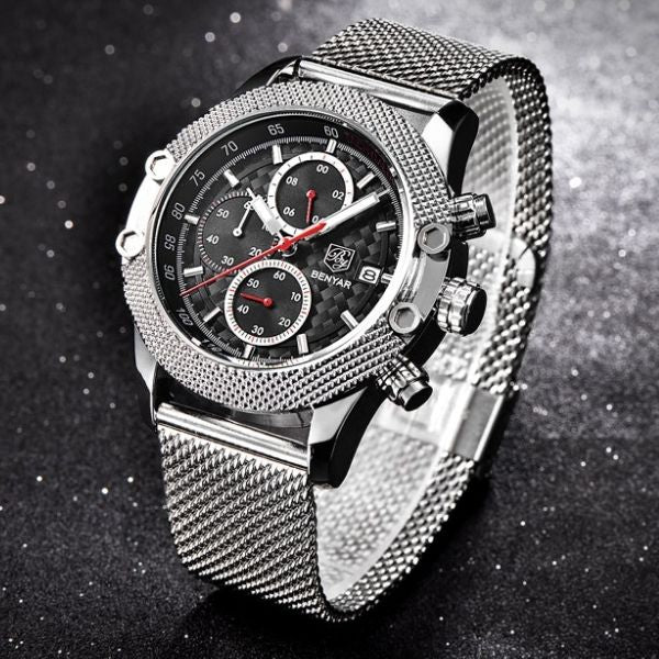 Man wearing silver Obelisk Chronograph Stainless Steel Watch with red markers on wrist