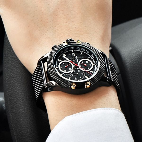 Man wearing black Obelisk Chronograph Stainless Steel Watch with red markers on wrist