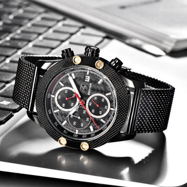 Black Obelisk Chronograph Stainless Steel Watch with red markers in gray background