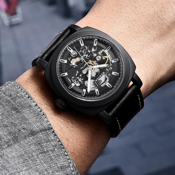Man wearing black Venal Skeleton Mechanical Watch on wrist