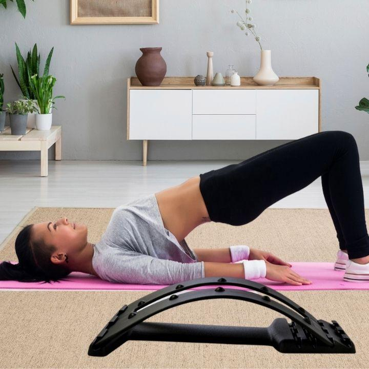a women use the Lower Back Pain Stretcher
