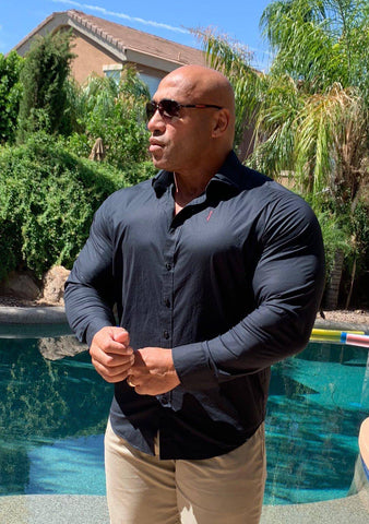 Dennis James IFBB Pro Bodybuilder Wearing Tailored Titans Dark Knight Shirt