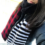 scarf with buffalo plaid on one end and black and white stripes on the other end