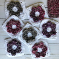 white solid crochet squares with flowers