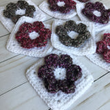 crochet flower squares in white and various colors