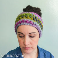 lady wearing a colorful ear warmer