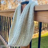 crochet infinity scarf hanging on post