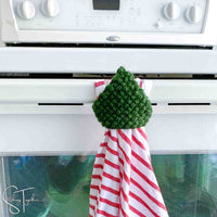 tree kitchen towel and topper hanging on an oven