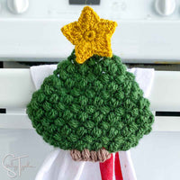 close up of crochet christmas tree with star and little trunk