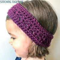 toddler wearing a purple crochet headband
