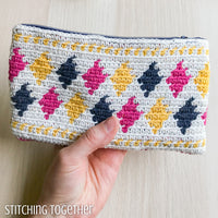 crochet pouch with colorful diamonds on it