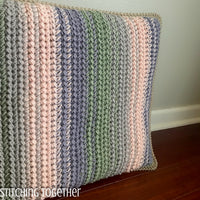 crochet cushion with stripes