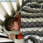 baby asleep under crochet blanket