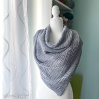 gray crochet triangle shawl on mannequin