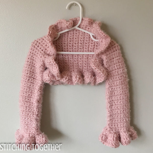 pink crochet shrug hanging