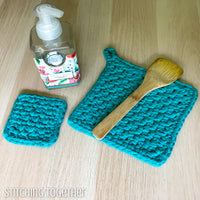 potholders crochet, soap and a wooden spoon