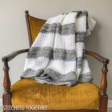 gray and white crochet throw