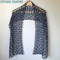 purple crochet lacy scarf draped on hanger