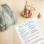 my crochet story printable next to yarn and hooks
