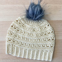 woman's crochet beanie with gray pom pom