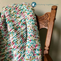 close up of colorful crochet baby blanket