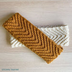 2 chevron crochet headbands laying on a table