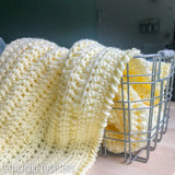 bulky crochet baby blanket in a basket
