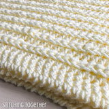 edge of a chunky baby blanket in crochet