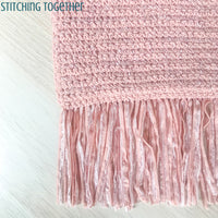 close up of fringe and stitches on crochet purse