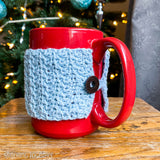 crochet mug cozy on red coffee mug