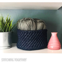 blue crochet basket sitting on shelf