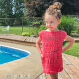 girl wearing a crochet dress while standing by a pool