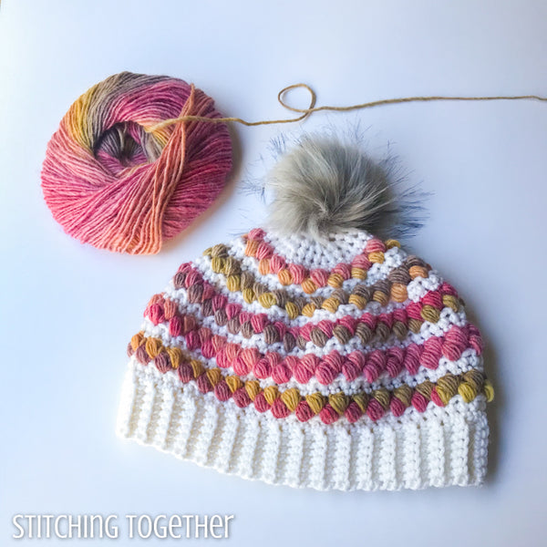 colorful women's crochet hat with a ball colorful yarn
