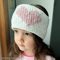 girl wearing crochet headband with heart