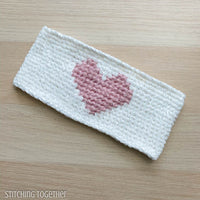 white crochet headband with pink heart