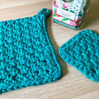 2 potholders crocheted in teal yarn