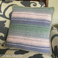 crochet pillow with differently colored stripes