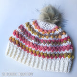 crochet women's hat with pom and colorful puff stitches