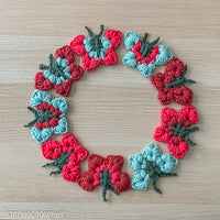 a circle of colorful butterflies crocheted