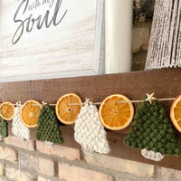 flat crochet christmas trees and dried orange garland